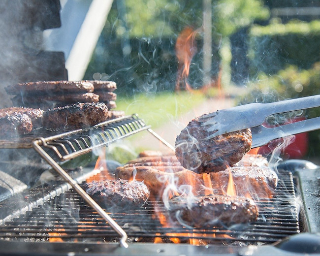 Grilling Burgers and Hot Dogs at West Tubing Company